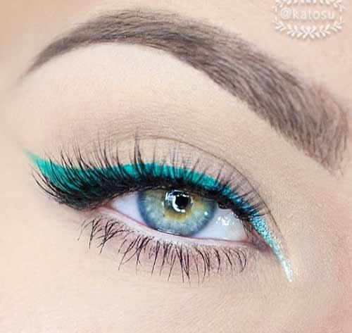 Голубые глаза и изумруд подводка
