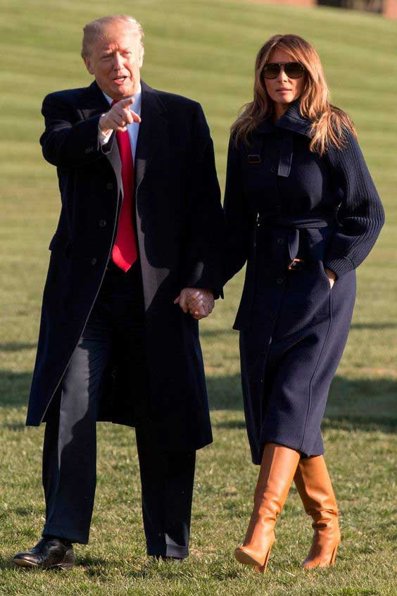 Мелания Трамп в высоких сапогах коричневого цвета