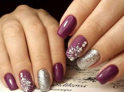 Серебристые снежинки на ногтях