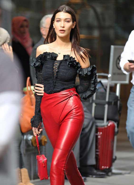 Белла Хадид - черная блузка кружева, викторианский стиль и красные брюки
