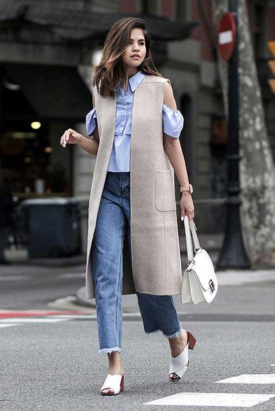 Серый жилет с джинсами и белой блузой