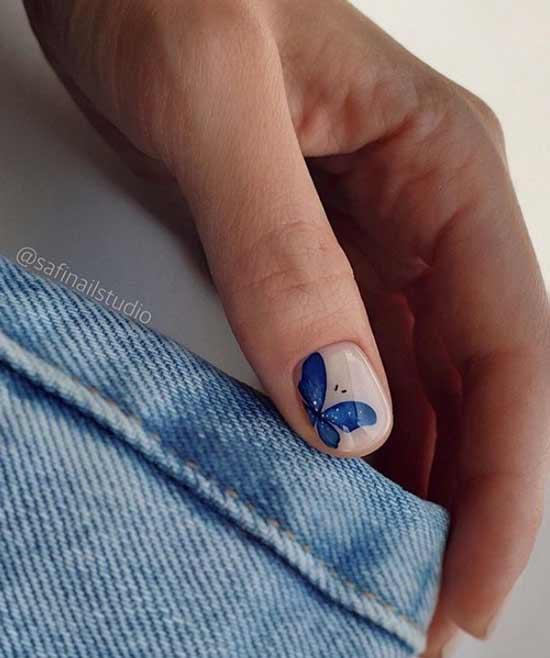 Фото ногтей с синей бабочкой