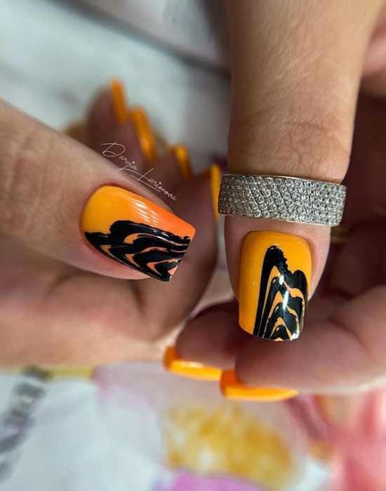 Оранжево-желтый маникюр с черным принтом