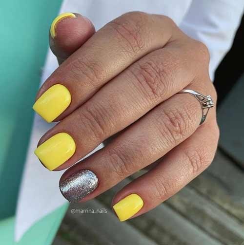 Ярко-желтый маникюр с блестками