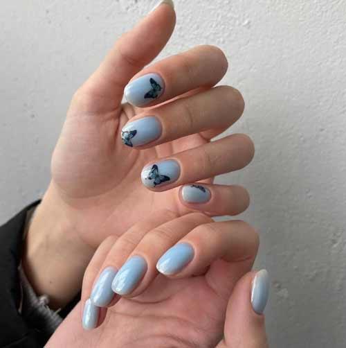 Черные бабочки на коротких ногтях