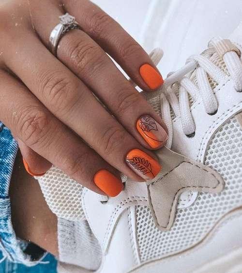 Листочки на оранжевых ногтях